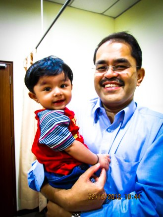 7 month old Jay all smiles with Dr. Fabian.