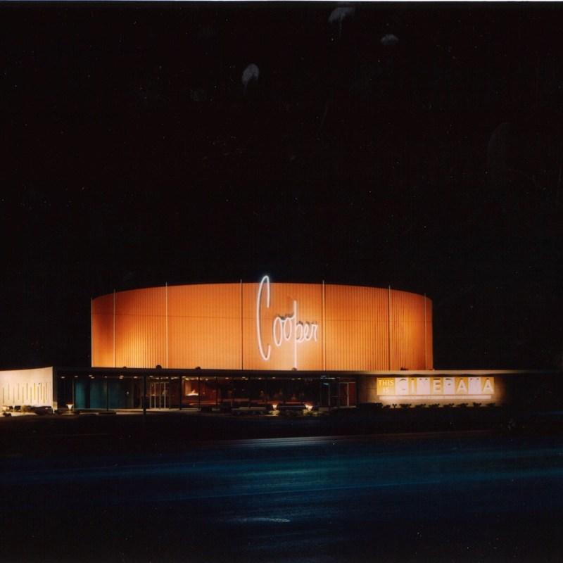 Denver Cinerama Theatre, Denver, CO. Theatre front lit up at night.