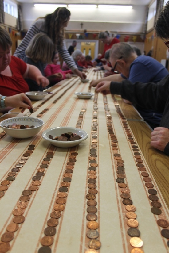 rows of pennies on striped paper