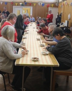 People sitting at tables ready to count their pennies