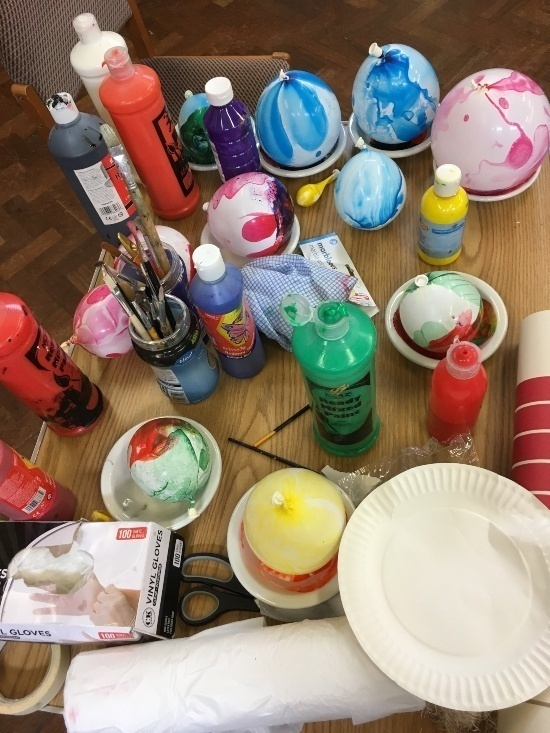 a collection of paints and painting equipment