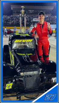 Ike Bevin poses with a trophy next to the car he won it in. the 16-year-old driver is now sponsored by Copart as part of Lee Faulk Racing.