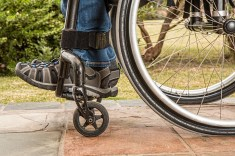 closeup of feet and wheels of wheelchair