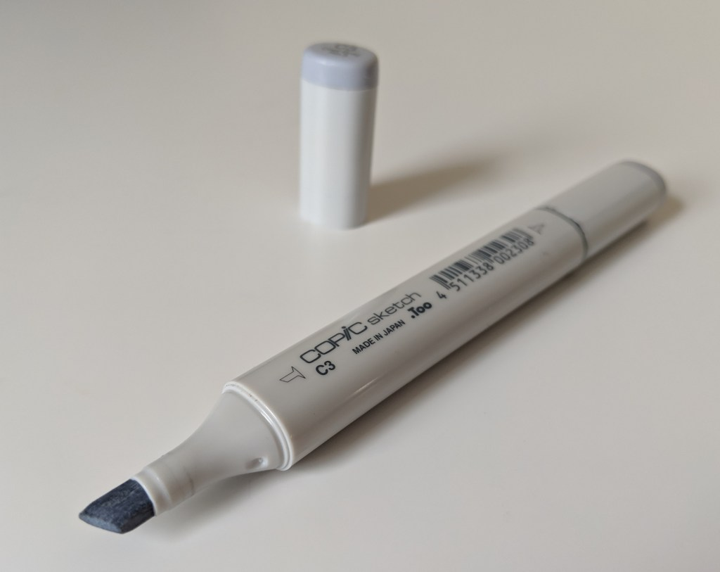 A Copic Sketch type of marker in colour C3 with non-stackable lid.