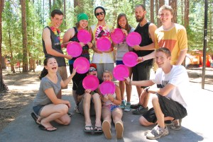 The Junior Counselors holding pink plates in a heart shape.
