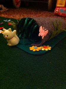 Secret hideaway cave that's removable for easy play mat storage