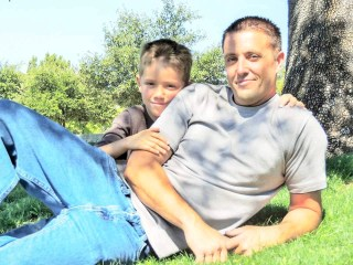 Plumbing Technician Clint Johnson posing for a photo with his son