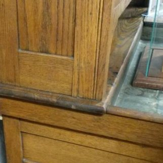 The early Coppes, Zook & Mutschler Co. cabinets had the top section set directly on the bottom section, usually with a bracket on the back to prevent tipping forward.