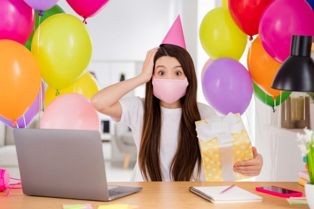 virtual party picture with the copycat party company, virtual entertainment services, girl surrounded by balloons attending an online party