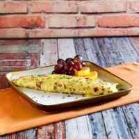 Tortilla de tentación casera de IHOP Tortilla y fruta en un plato