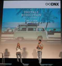 marcus meurer and felicia hargarten on stage dnx conference