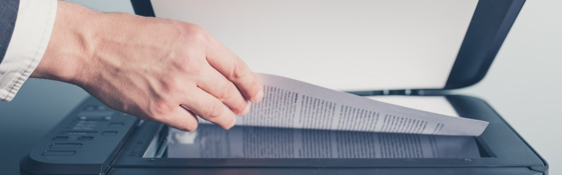 Hands of businessman copying document