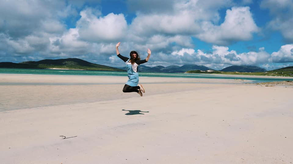 Me jumping up with my arms in the air at Seilebost Beach