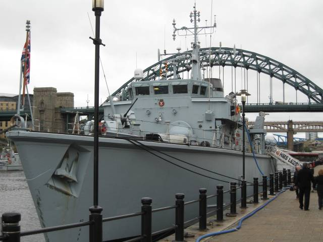 The Tyne Bridge with a battleship