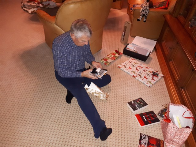 Dad unwrapping presents