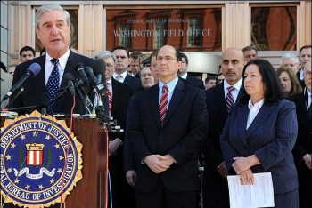 FBI Director Robert S. Mueller speaks at the press conference at the Washington Field Office.