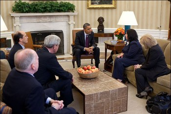 President Barack Obama meets with Christine Levinson in the Oval Office on March 6, 2012.