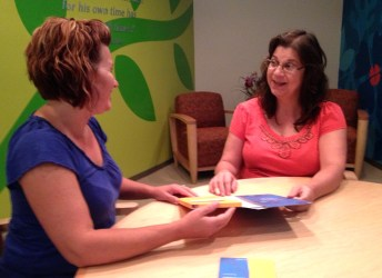 Science Care Family Services Manager Stephanie Shenefelt (left) discussing the program with a potential donor