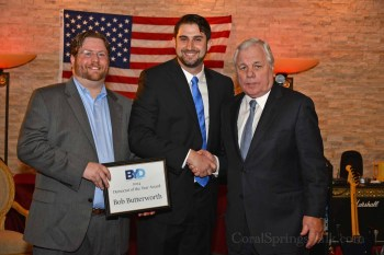 """BYD President Michael Friedel and Vice President Andrew Gordon honor Former Attorney General Bob Butterworth with a """"Democrat of the Year"""" award."""