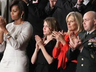 Mast stands with First Lady Michelle Obama at the State of the Union address.