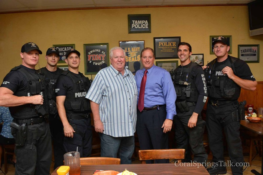 Wings Plus owner Brian Walsh along with Coral Springs Police Chief  Tony Pustizzi and officers.