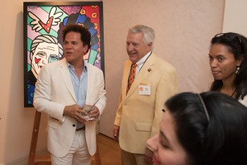Romero Britto with art patron Steve Opler.