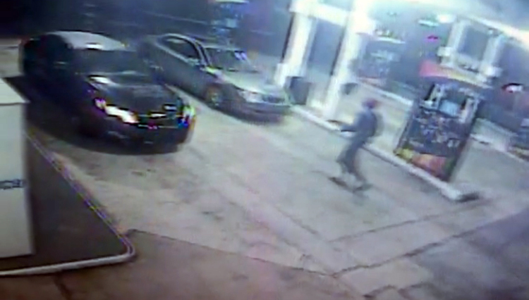 Surveillance from the Sunoco shows the suspect casing the car.