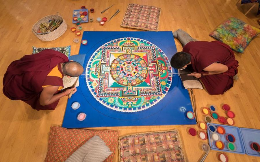 Tibetan Monks constructing the Sand Mandala in Coral Springs in 2016. Photo by Adam Baron.