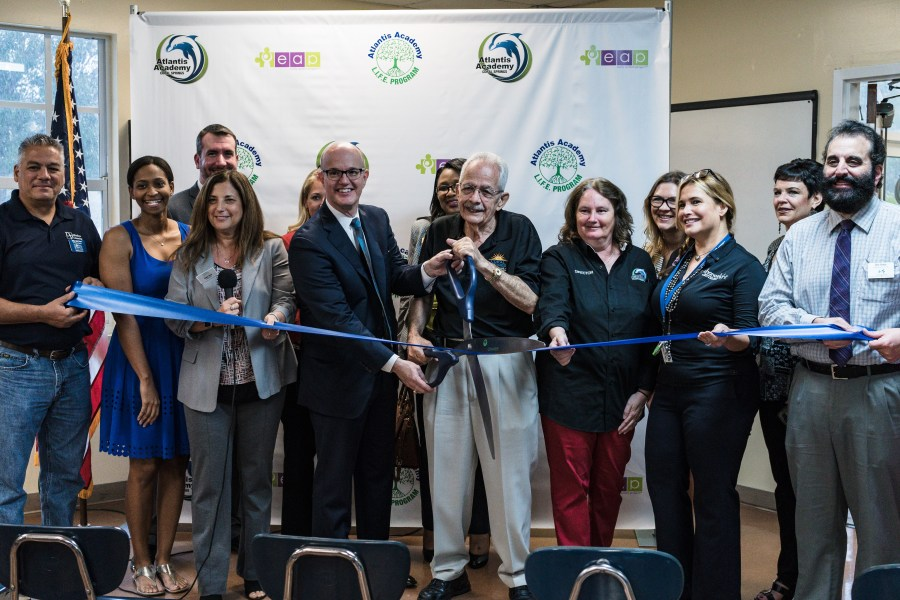 Ribbon cutting for the Atlantis Academy Early Autism Project.