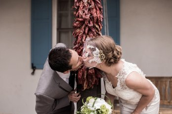 Couple Shares a Loving Kiss in Front of a Ristra