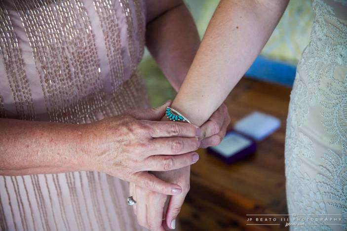 Bride's Mother Helps with Her Bracelet