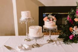 Three Sweet Cakes Sit Upon Crystal Embellished Stands