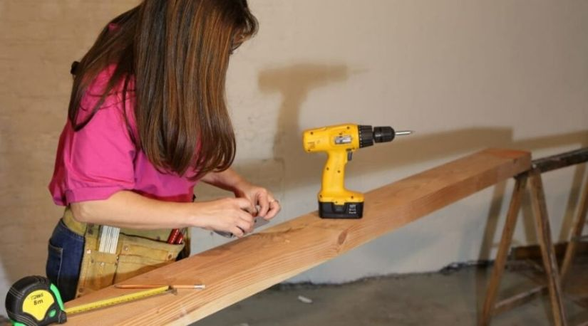 A person assembling best cordless hammer drill for use i a wooden material