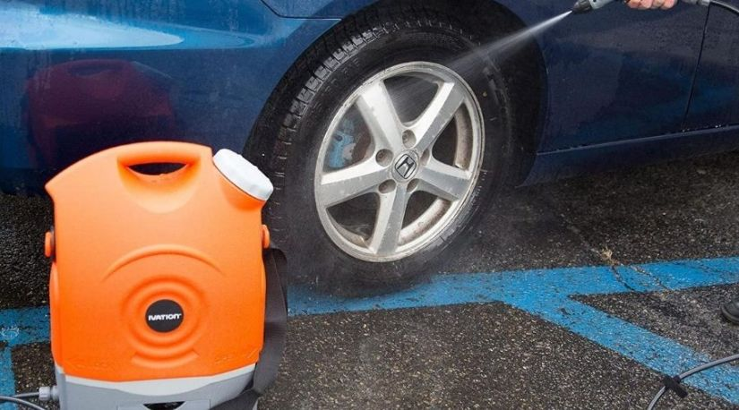 Best Cordless Pressure washer in use to clean a car