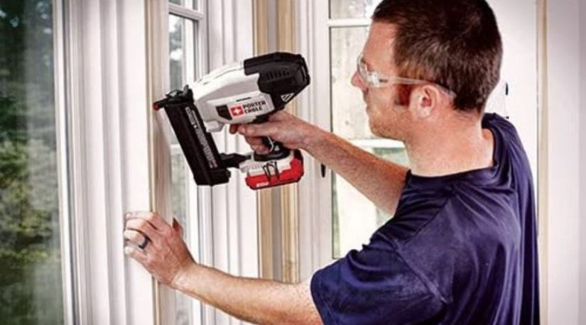 A picture of a man employing the use of PORTER-CABLE 20V MAX Cordless Brad Nailer, one of the best cordless brad nailer models you can find in the market