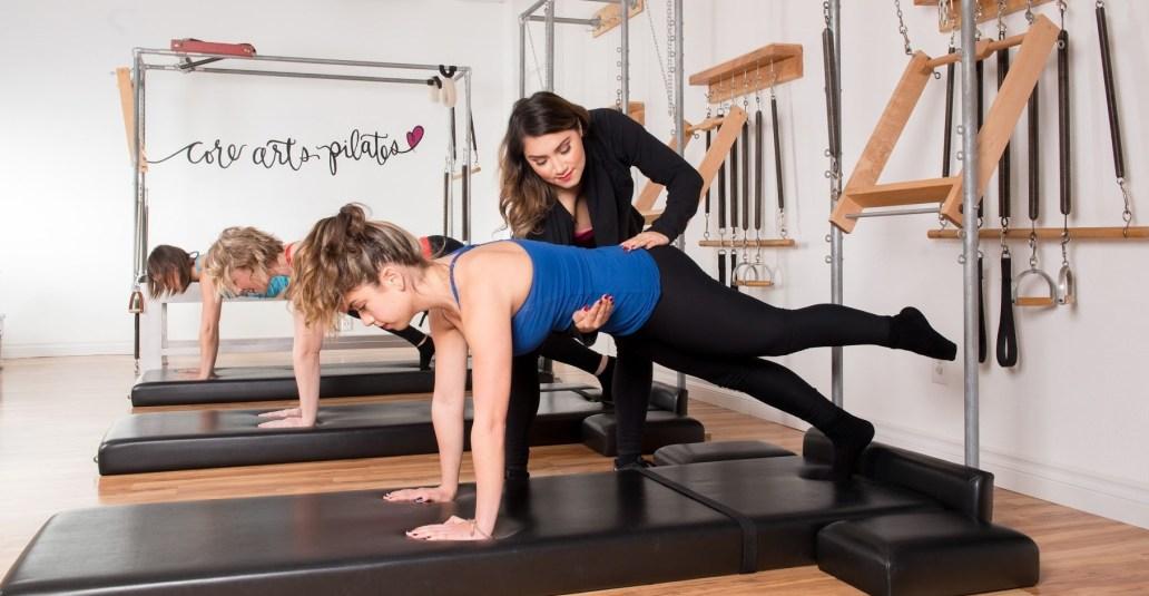 Jordan teaching a mat class at Core Arts Pilates