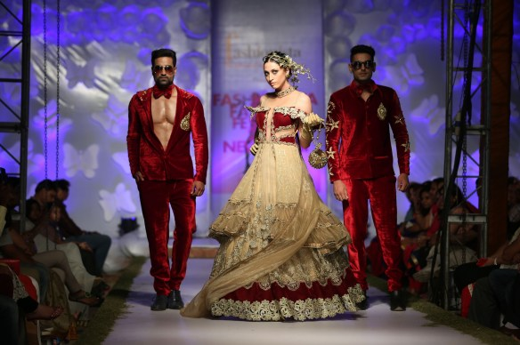 Male and Female models set the ramp on Fire wearing Golden Paradise Theme