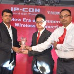 Mr.Bruce Zhou and Mr. Pinaki Chatterjee handing over momento to Redington on signup of National distribution