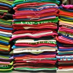 Stack of Colorful t-shirt for use as Background