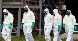 Cleaners enter the Holyoke Soldiers' Home in Holyoke, Massachusetts, where a coronavirus outbreak has killed more than 40 veterans. Getty/Jessica Rinaldi/The Boston Globe