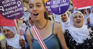 Women hold signs as they take part in a demonstration against government plans to ban or limit the practice of abortion in Turkey on 22 June 2012, in Istanbul. Reuters