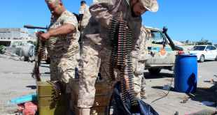 Militants prepare their ammunition in April 2019 before joining frontline to defend Tripoli against Khalifa Haftar's forces. EPA-EFE