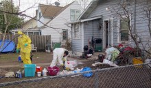 Police clean out a meth lab discovered in the basement of 5137 Abbott Av so when they served a fugitive warrant Friday, April 11, 2014.
