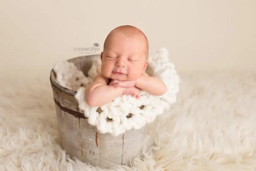 Newborn Boy in Bucket