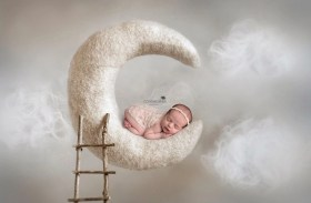 sleeping newborn crescent moon