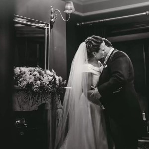 Beautiful candid romantic bride and groom kiss