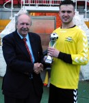 Man of the Match: Dominic Kelleher (Strand United) receives the Man of the Match from Martin Conlon (Cork AUL)