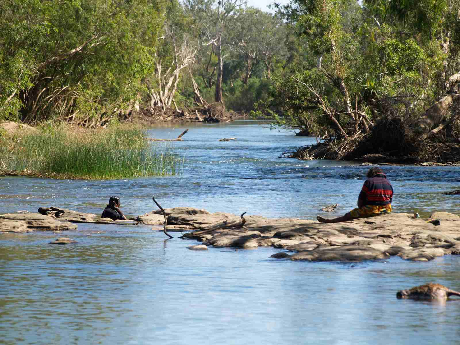 Aboriginal girls fishing on the Katherine River @ Katherine