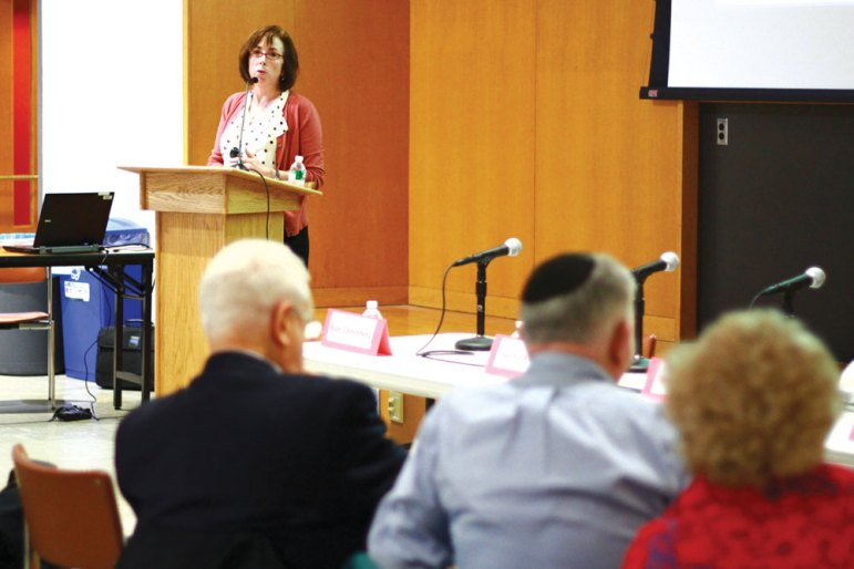 Prof. Suzanne Mettler, government, speaks about the importance of financial aid (Sonya Ryu / Sun Senior Photographer).