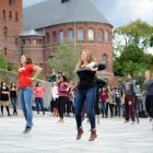 Cornell dance troups perform a four minute flash mob on Ho Plaza Wednesday.  (Brittany Chew / Sun News Photographer)